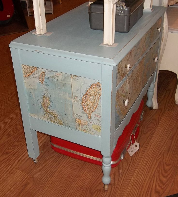 Side profile of small decoupaged dresser