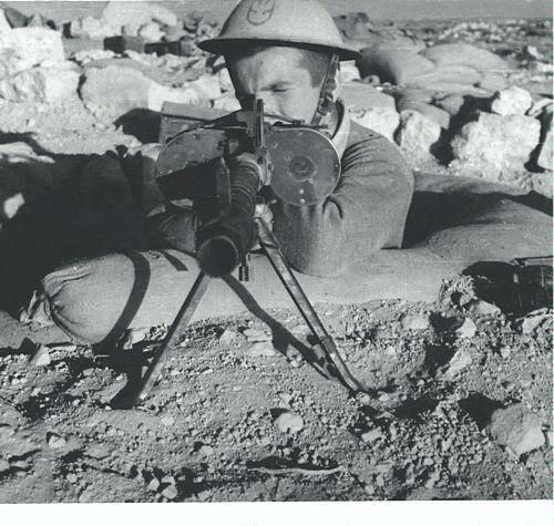 Polish soldier of the Carpathian Lancers Regiment with captured MG-34, first Siege of Tobruk, World War II.