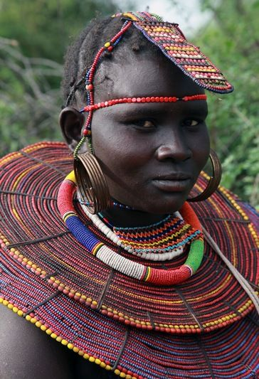 """Colours have a significance in Maasai culture.  Black: """"...represents the color of the people but more importantly the hardships we all go through in life. It suggests that difficult times occur with everyone because those difficulties are part of the same, natural sequence of life"""""""