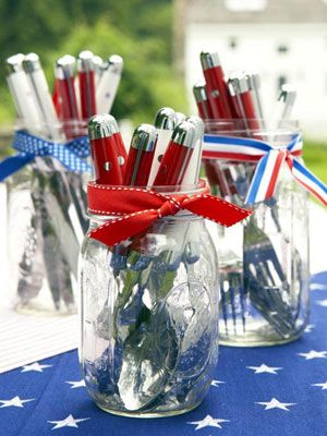 Fourth of July Party Silverware.. Navigating the backyard buffet is a breeze for plate-balancing guests when you station grab-and-go silverware in glass canning jars. Trim a trio of jars with ribbon remnants, and fill with eco-friendly reusable flatware.