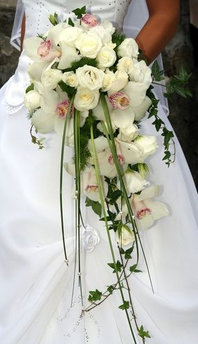 I like the simplicity of this one\'s size, but with green hydrengeas, orange roses, white sweet peas, and blue ribbon