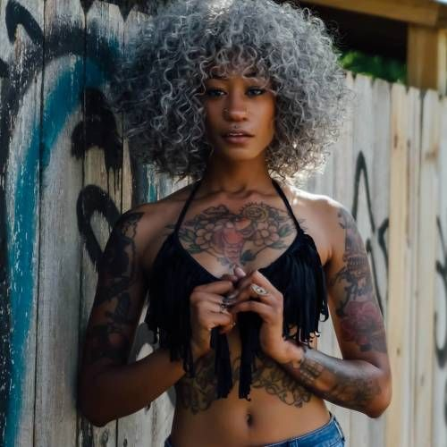 black women wearing tattoos candy paint arms body