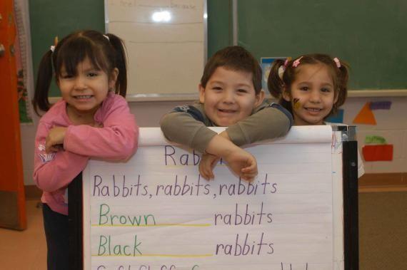Three children in a classroom