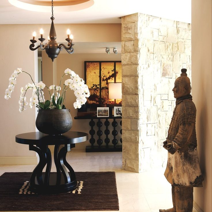 A Pierre Cronje custom designed entrance hall table in situ.  Interior design by Antoni Associates