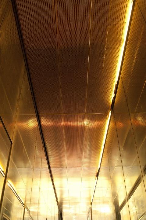 Sven-Harry's Art Museum by Gert Wingårdh. Copper mesh detail in open hallway btw house bodies.
