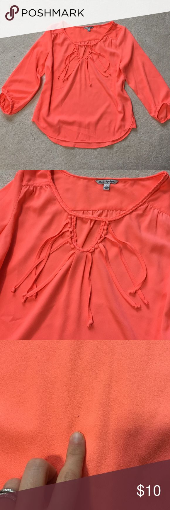 American Eagle Neon Orange fringe blouse size S American Eagle neon orange fringe blouse in size Small. There is a small mark on the front. Looks like a pencil mark. If you look at the 3rd picture you can see it there. American Eagle Outfitters Tops Blouses