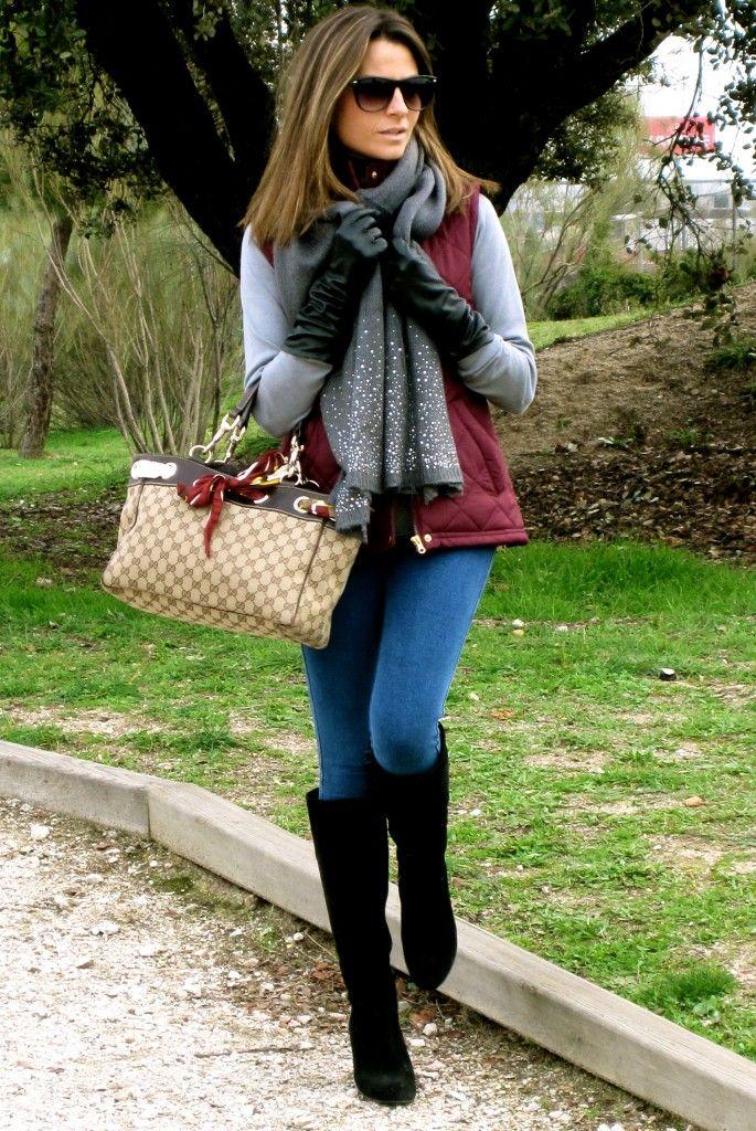 Burgundy vest, gray turtleneck, jeans but a black leather satchel instead.