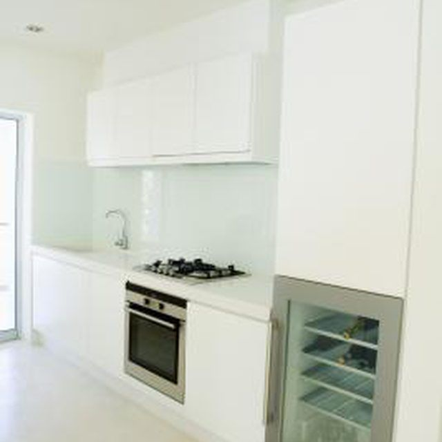 How to Reface Kitchen Cabinets With White Merillat Rigid ...