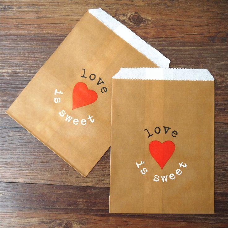 Paper gift kraft bags with a heart    Бумажные подарочные крафтовые пакеты с сердечком