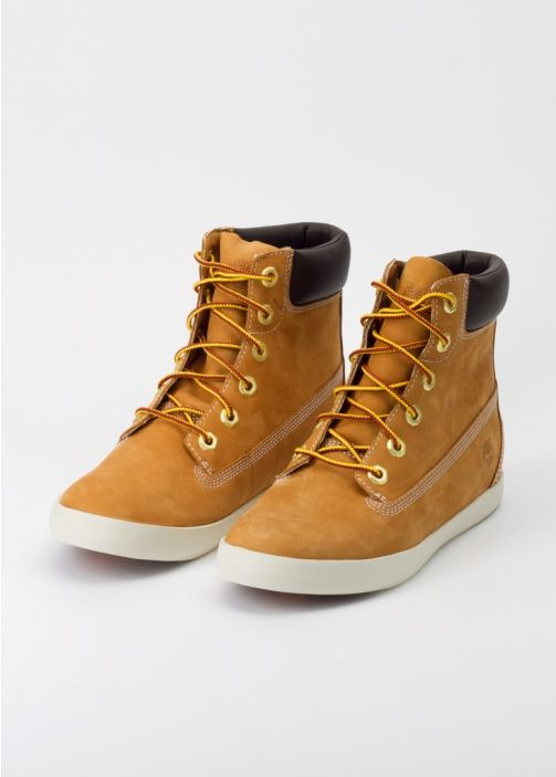 "This updated take on classic Timberland style features a unique sneaker sole with a hidden interior 1.5"" wedge. Pair with distressed denim for authentic Pacific N.W. style. By Timberland, via Wildfang."