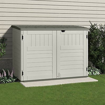 The Suncast Stow-Away Horizontal Storage Shed is great for storing lawn and garden supplies, mowers, bicycles, patio cushions and much more. The contemporary design will complement any backyard décor. The low profile is ideal for placement on the side of a house, patio or under a fence. Double-wall resin construction is durable and long lasting. Gas shocks make it easier to lift and keep the lid open. It includes a sturdy floor with ramp and extra reinforcement for heavier items. Padlock…