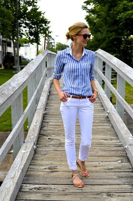 Preppy blue Oxford with white jeans and gold shoes.