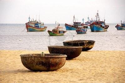 Fishing baskets and boats at Qui Nhon in Vietnam