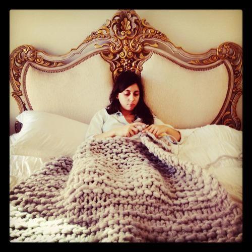Sophia is knitting with Loopy Mango big loop yarn and size 50 circular knitti...