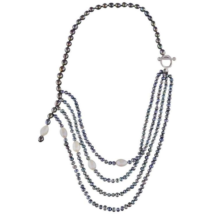 Vintage Black Pearl Asymmetrical Multi-Strand Necklace   From a unique collection of vintage multi-strand necklaces at https://www.1stdibs.com/jewelry/necklaces/multi-strand-necklaces/