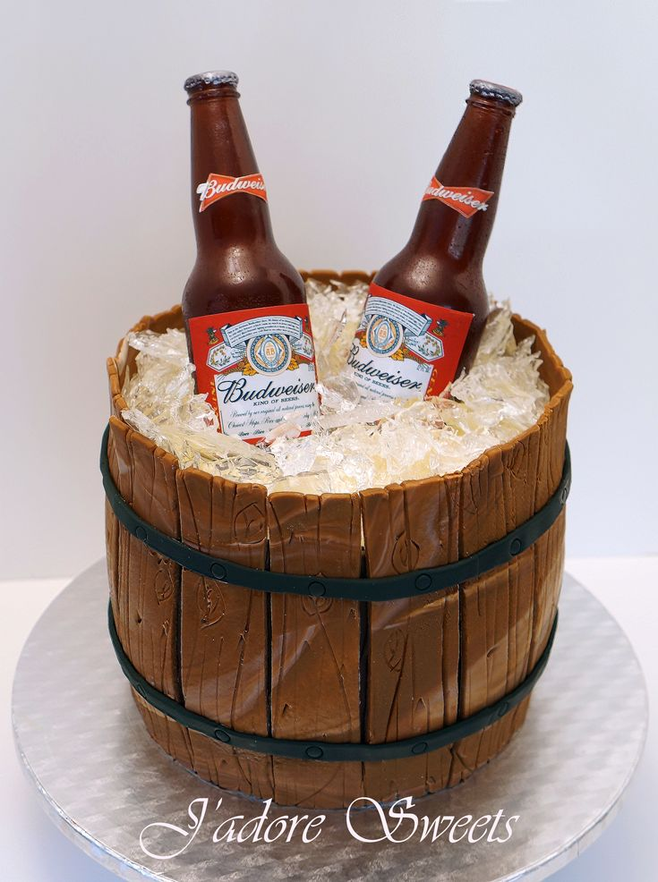 Beer / Wine / Cigars - 3D Sugar beer bottle in a barrel cake  The sugar beer bottles and sugar ice chips are isomalt. I made my own beer mould using Easy Mold, a mailing tube, clay and following the awesome tutorial by Chef Dominic Palazzolo. The barrel is half RKT and half pandan chiffon cake made with white chocolate ganache, fondant and modelling chocolate. Beer labels are edible images.