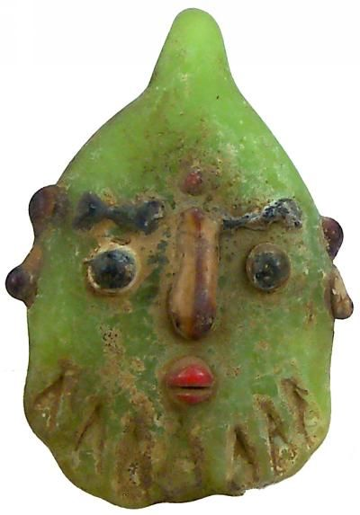 Phoenician light green fused glass face pendant, ca. 400-200 BCE. These look SO modern that it kinda freaks me out a little.