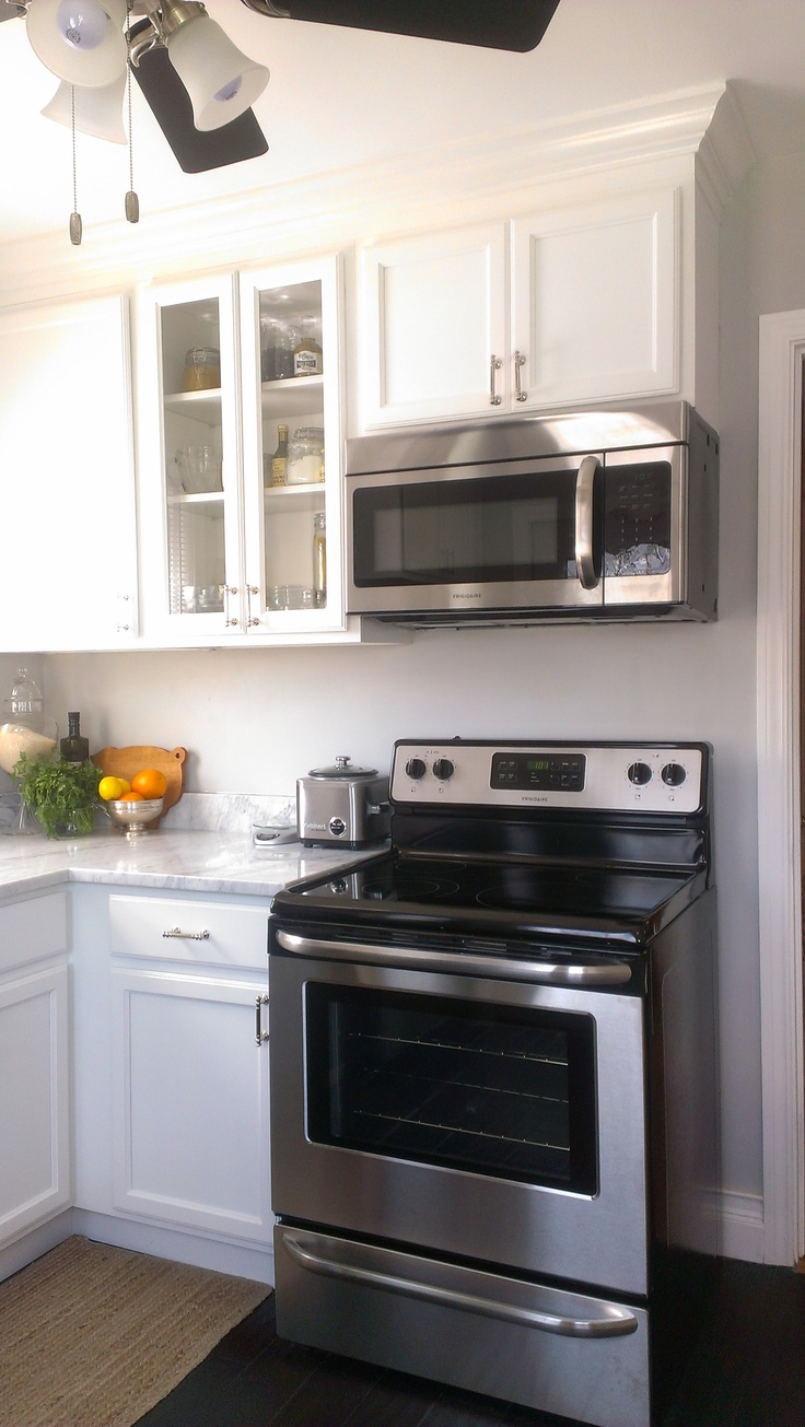 small kitchen white cabinets carrara marble countertop