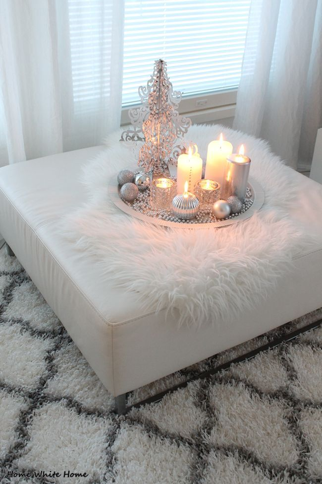 Here's a fun Christmas display of white and silver accents on a bedroom ottoman. Just love the white fur throw!