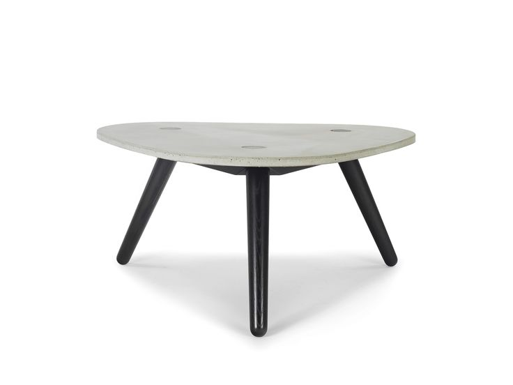 The CRETE coffee table radiates durability. The table's form and asymmetrical legs create a lightness and elegance despite the heavy, sturdy concrete table top. The top has been treated with an anti-dirt coating but will, over time, change its character and take on an individual look through humidity and normal use.