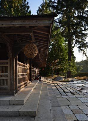The patterning of paving, sunlight falling through the trees and the intricate carving of the teak Kudus house all add to the new garden's a...