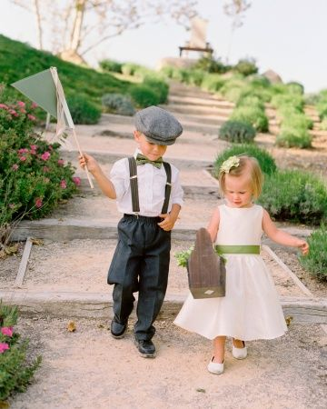 Littlest Attendants  Ring Bearer and Flower Girl (brother and sister), carried a paper flag and a wooden basket of blooms.