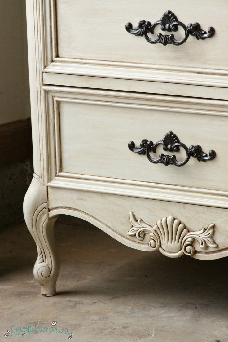 Paint: General Finishes Antique White Glaze: General Finishes Van Dyke Brown -- just paint it on and wipe it off (working in sections) Top Coat/Sealer: General Finishes High Performance Top Coat in Flat Hardware: Rust-Oleum Oil Rubbed Bronze and a spray polycrylic to seal the paint