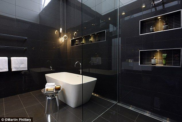 Mood lighting: Looking homely the bathroom featured a hidden storage compartment for towels