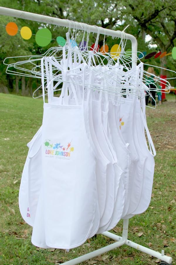 "art party idea | buy white aprons and ""iron on"" paper to make a design for the party on the apron"