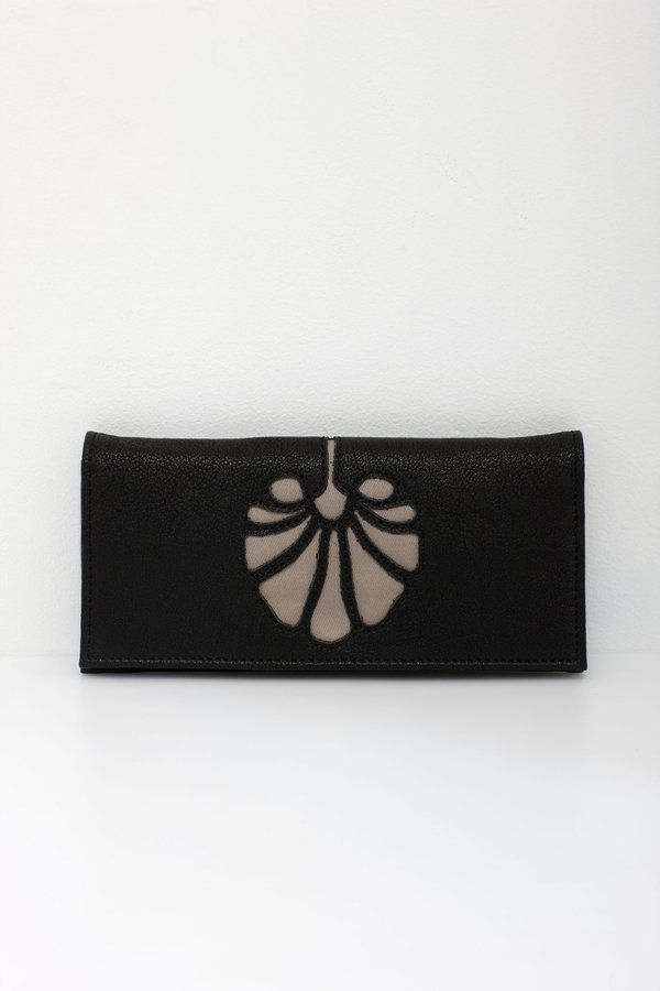 A slim line wallet with art deco cut-out details. A great addition to the matching Millie Bag    ten card slots  three internal notes sections  zip coin...