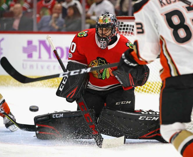 CHICAGO, IL - NOVEMBER 27: Corey Crawford #50 of the Chicago Blackhawks watches a shot come in against the Anaheim Ducks at the United Center on November 27, 2017 in Chicago, Illinois. (Photo by Jonathan Daniel/Getty Images)