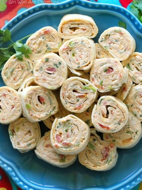 These+Chicken+Enchilada+Roll+Ups+are+a+great+appetizer+for+parties!+Easy+to+make+ahead+and+easy+to+serve.+the-girl-who-ate-everything.com