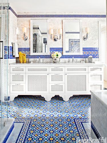 A T-shaped carpet of tile in a Moroccan pattern.