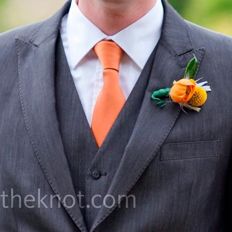 orange tie and grey suit. I am thinking I want a boutonneire with a blue thisle and orange flower...