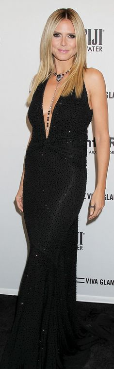 Who made  Heidi Klum's diamond jewelry, clutch handbag, shoes, and black gown that she wore in New York on February 6, 2013?