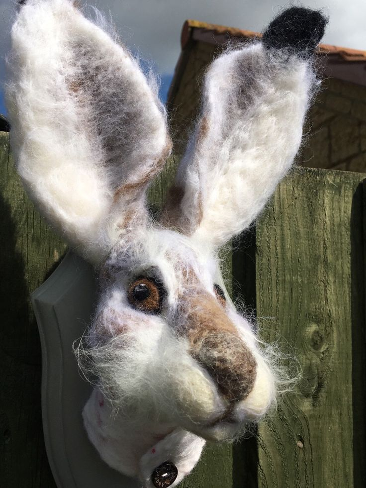 A personal favourite from my Etsy shop https://www.etsy.com/uk/listing/275601054/white-hare-needle-felted-faux-taxidermy