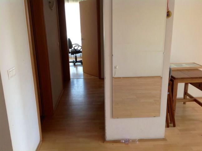 Living room, view to bedroom corridor + kitchen