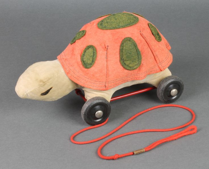 """Lot 238, A Merrythought pull along figure in the form of a tortoise 11"""", est £30-50"""