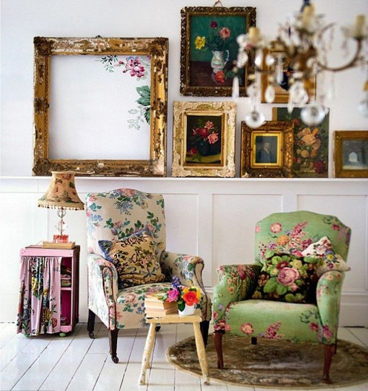 White walls and a bare white wooden floor make sure the overall effect of these flower prints in ornate gold frames isn't too busy. Look at the frame on the left with the flowers painted on the wall inside: isn't that an inventive trick?