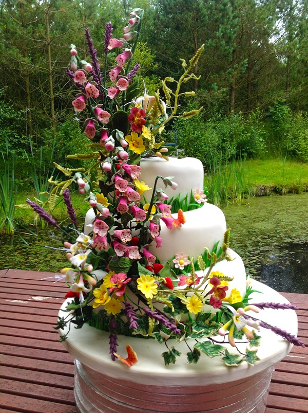 Sugar Flower Fox Gloves are the first of our new floral online courses. They are featured in this Summer Woodland Wedding cake.