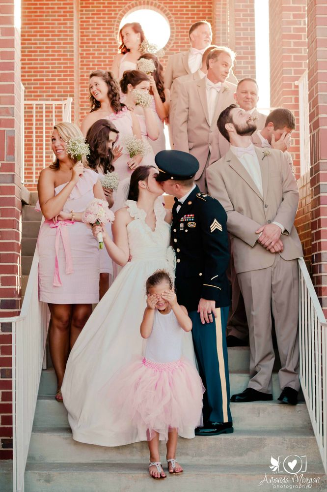 Get a room, you two! Cute photo op for the newlyweds and the wedding party | Amanda Morgan Photography
