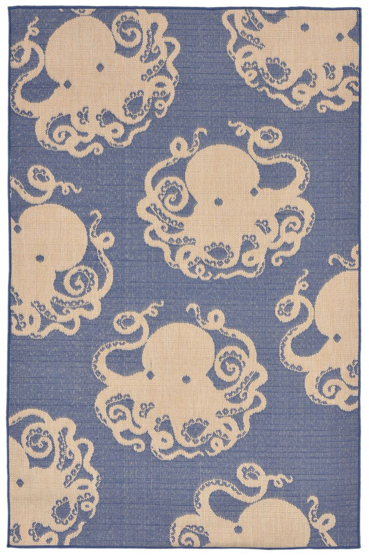 Neutral octopus images make up the pattern in this distinctive marine blue blended yarn make this machine made rug a lighthearted accent to add to your coastal home.