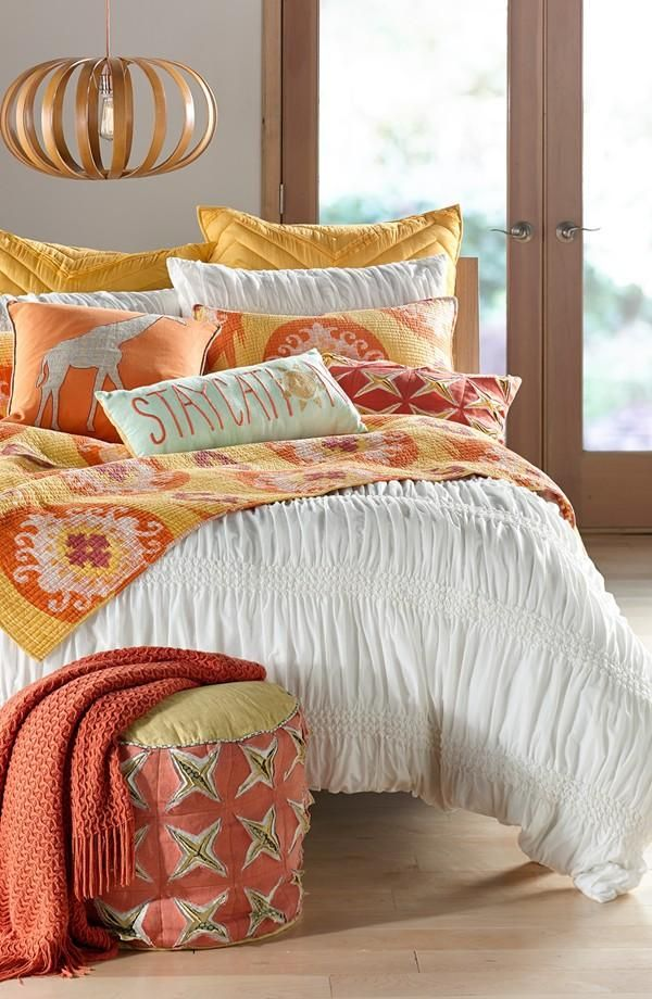 Create a happy bedroom with bright yellow and orange hues.