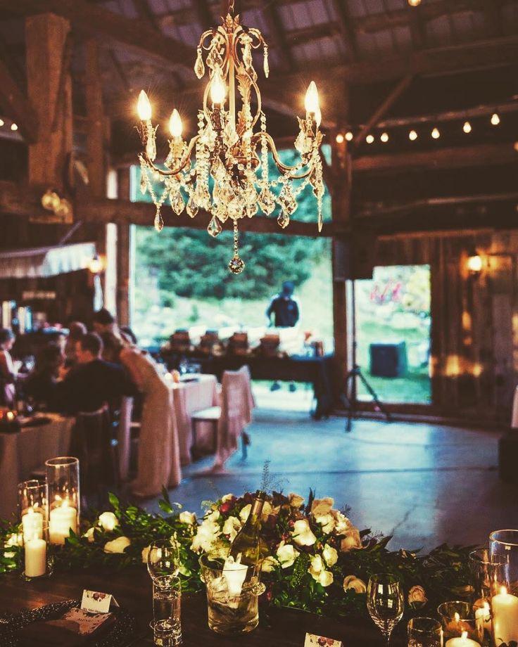 Who says rustic chic can't also be elegant? A crystal chandelier brings a touch of luxury to any event ✨ photo by @jessrosephoto  #elegance #rusticchic #rusticwedding #barnwedding #chandelier #crystalchandelier #northfork #ottawawedding #ottawaweddingplanner #luxury #Ottawa #toronto #montreal