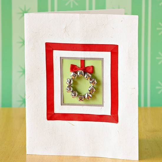 Musical Greeting Card This card will jingle all the way to the mailbox. Simple grosgrain ribbon frames a neat square of layered handmade papers. To complete the look, arrange and glue miniature bells in a wreath shape and top with a tidy grosgrain ribbon bow.