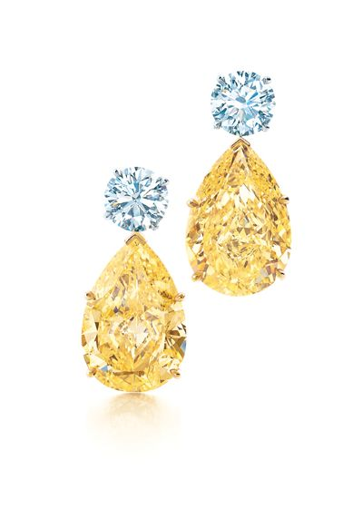 Tiffany & Co. yellow and white diamond earrings in platinum.