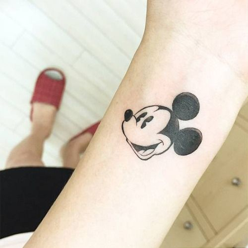 Little wrist tattoo of Mickey Mouse. Tattoo artist: Banul