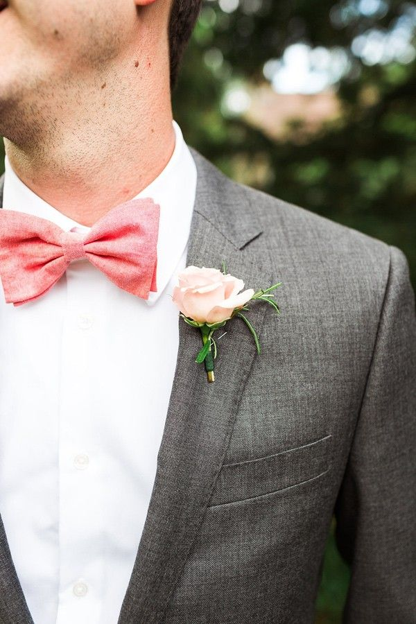 Coral bow tie and blush pink rose button hole.