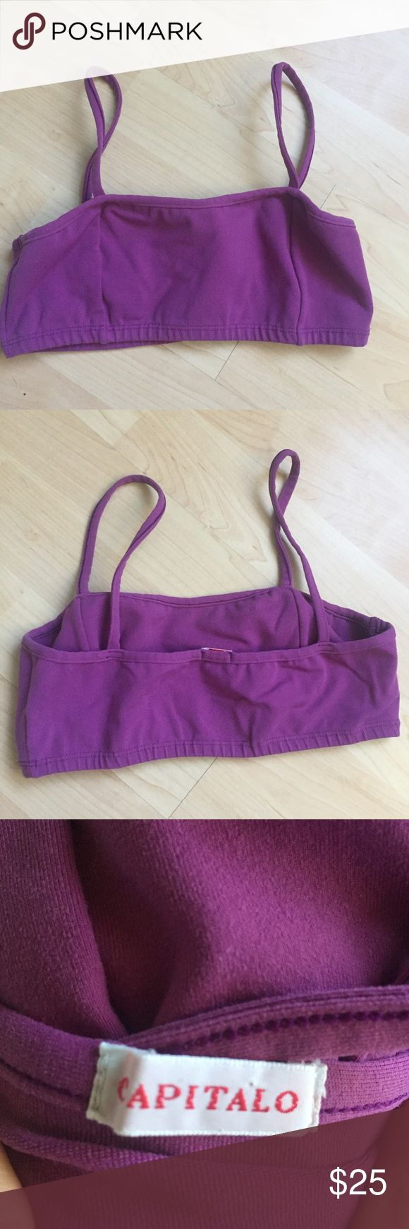 Purple sports bra Brand is Capitalo, purchased from a high end boutique on Maui. High quality material, thick and stretchy. Very flattering but doesn't fit my chest anymore! Worn lightly a few times. Great condition. I don't know the size but I would guess could fit a 32/34 B/C quite well. capitalo Intimates & Sleepwear Bras