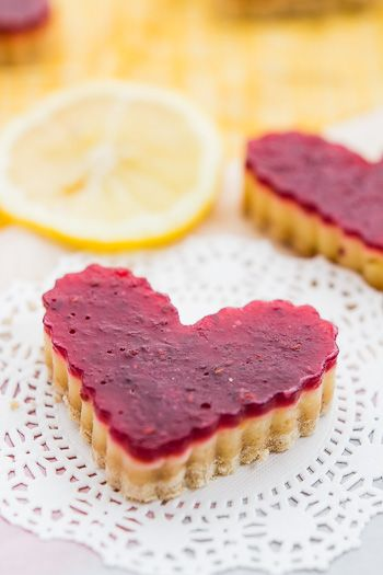 A lightened up version of the classic lemon bar with a delicious raspberry twist. A de-LIGHTful treat for anytime of the year.
